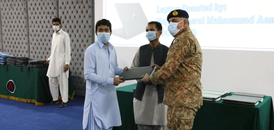 GOC distributes laptops among the students of UoT's Gwadar campus